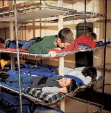 Kids sleep in bunks at Battleship Cove